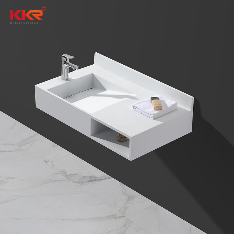 Piedra de resina acrílica superficie sólida pared colgada lavabo con pendiente y toallero estantes KKR-1335