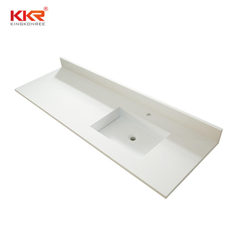 Solid surface bathroom vanity top with wash basin