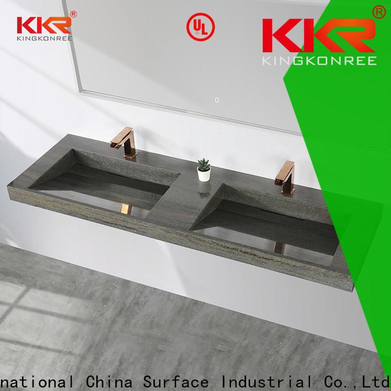 concrete black wall hung basin design for hotel